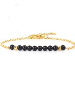 Bracelet dore pierre noir