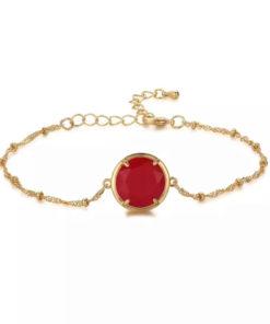 Bracelet fantaisie avec pierre rouge
