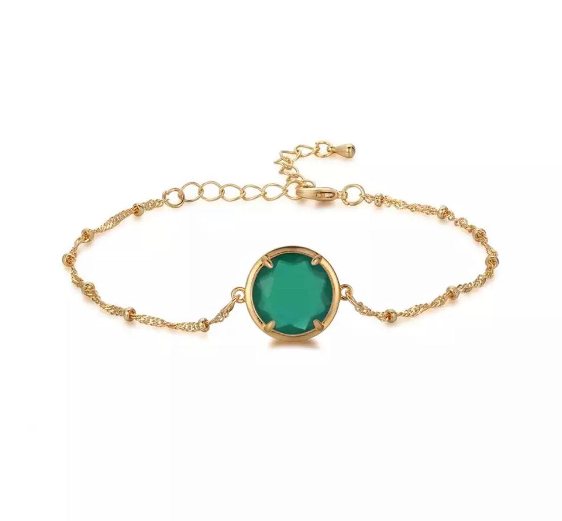 Bracelet fantaisie avec pierre verte